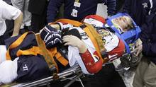 Florida Panthers forward David Booth is wheeled off the ice after being injured in the second period of an NHL hockey game against the Philadelphia Flyers, Saturday, Oct. 24, 2009, in Philadelphia. (Matt Slocum)