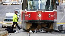 The scene of a fatal collision involving a cyclist and a TTC streetcar in Toronto on Friday morning. (Peter Power/The Globe and Mail/Peter Power/The Globe and Mail)