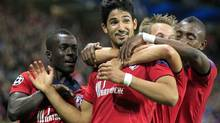 Tulio De Melo (C) of Lille celebrates with team-mates after scoring his goal during their Champions League play-off second leg soccer match against Copenhagen at the Lille Grand Stade stadium in Villeneuve d'Ascq August 29, 2012. (PASCAL ROSSIGNOL/REUTERS)