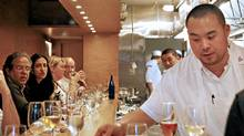 Chef David Chang serves a dish to a patron during dinner service at Momofuku Ko in the East Village neighborhood of New York. (Chris Goodney/Bloomberg News)
