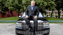 Councillor Doug Ford poses for a photograph on the hood of his Lincoln Navigator outside of City Hall (Matthew Sherwood for The Globe and Mail/Matthew Sherwood for The Globe and Mail)