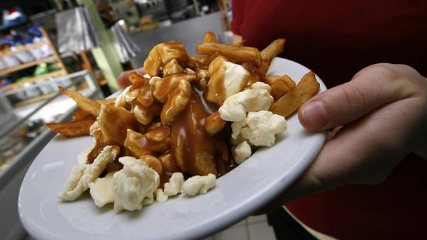 A serving of poutine heads out to a customer at La Formagerie du Village in Warwick, Que.