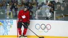 Canada's Sydney Crosby looks on as members of the media stand behind him during their men's team ice hockey practice at the 2014 Sochi Winter Olympics, February 12, 2014. (MARK BLINCH/REUTERS)