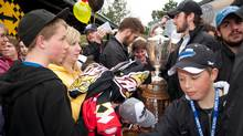 The 2011 OHL Champions Owen Sound Attack celebrate with fans before departing for the Memorial Cup, in Owen Sound, May 18, 2011. (Kevin Spreitz)
