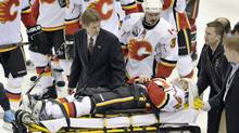 Calgary Flames center Daymond Langkow is taken from the game on a stretcher after being injured against the Minnesota Wild during the second period of an NHL hockey game Sunday, March 21, 2010, in St. Paul, Minn. Langkow was hit in the back of the neck with a puck and did not appear to be moving as he was removed from the ice on a stretcher. (AP Photo/Tom Olmscheid) (Tom Olmscheid/AP)