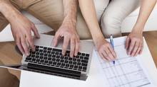 Young Couple Doing Family Finances At Laptop At Home  (Andrey Popov/Photos.com)