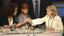 """This image released by ABC shows, Oprah Winfrey, left, grasping hands withBarbaraWalters, right, as co-host Sherri Shepherd looks on during a taping ofWalters' final co-host appearance on """"The View, """" Thursday, May 15, 2014 in New York. (IDA MAE ASTUTE/ASSOCIATED PRESS)"""