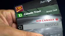 Cards from CIBC, TD Bank and Aeroplan as shown Thursday, June 27, 2013 in Montreal. (Ryan Remiorz/THE CANADIAN PRESS)