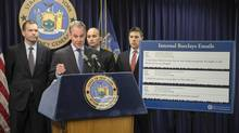 New York state's Attorney-General Eric Schneiderman speaks during a news conference to announce his office is filing a securities fraud lawsuit against the banking and financial services firm Barclays, Wednesday, June 25, 2014, in New York. The suit alleges that Barclays told investors that it had set up safeguards to protect them from predatory high-frequency traders. But it says Barclays actually catered to those traders. (John Minchillo/AP)