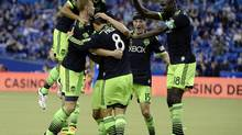 The Seattle Sounders celebrate their goal scored against the Montreal Impact during the first half at the Olympic Stadium. (Eric Bolte/USA Today Sports)