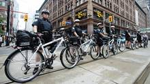 A column of police officers lines a street in Toronto ahead of the G20 summit. (Mark Blinch/Reuters/Mark Blinch/Reuters)