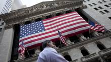 A pedestrian walks past the New York Stock Exchange on Monday, Aug. 8, 2011 in New York. All signs point to a sharp decline when trading begins in U.S. markets this morning. (Jin Lee/Jin Lee/The Associated Press)