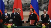 Russian Prime Minister Vladimir Putin meets Chinese Premier Wen Jiabao at the Great Hall of the People in Beijing on Tuesday. (Takuro Yabe/Getty Images)