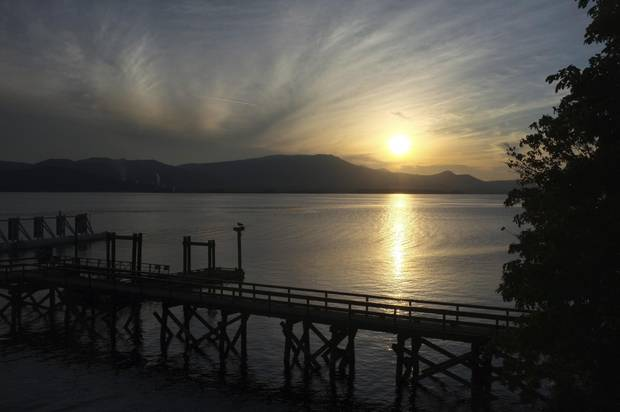The sun sets behind the dock at Vesuvius, a small village on the west side of B.C.'s Salt Spring Island.