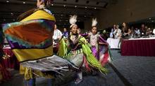 A group of youth from Sixth First Nations in Manitoulin Island perform the grass, fancy and jingle dances during the opening ceremonies of The Assembly of First Nations Annual General Assembly in Toronto on July 17, 2012. (Michelle Siu/The Canadian Press)