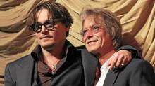 "Director Bruce Robinson with Johnny Depp at the premiere of ""The Rum Diary"" in Los Angeles on Oct. 13, 2011. (Eric Charbonneau/WireImage)"