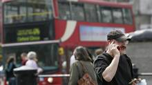 Canadians spent almost $800-million on worldwide roaming charges last year. (Lefteris Pitarakis/The Associated Press)