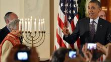 U.S. President Barack Obama makes remarks to guests next to a menorah at the conclusion of a Hanukkah reception, marking the Jewish Festival of Lights holiday, in the Grand Foyer of the White House in Washington, December 5, 2013. (MIKE THEILER/REUTERS)