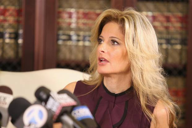 Summer Zervos speaks to the press with her attorney, Gloria Allred, in Los Angeles on Oct. 14, 2016.