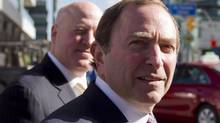 NHL Commissioner Gary Bettman (right) arrives with deputy commissioner Bill Daly for collective bargaining talks in Toronto on Wednesday October 16, 2012. (The Canadian Press)