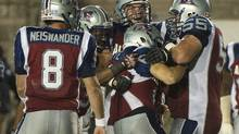 Players from the Montreal Alouettes celebrate after defeating the B.C. Lions in CFL football action in Montreal, Thursday, August 22, 2013. THE CANADIAN PRESS/Graham Hughes (GRAHAM HUGHES/THE CANADIAN PRESS)