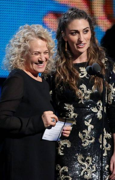 Carole King, left, and Sara Bareilles presents the award for song of the year at the 56th annual Grammy Awards at Staples Center on Sunday, Jan. 26, 2014, in Los Angeles. (Matt Sayles/Invision/AP)