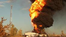 An explosion erupts at Speedway International, a methanol fuel plant in Winnipeg on Oct. 1, 2012. (Christine Morin/THE CANADIAN PRESS)