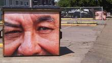 An art program through the police department in Edmonton publishes photographs taken by community members and police on dumpsters. (Bill Grimshaw for The Globe and Mail)
