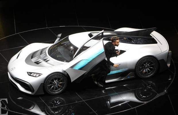 F1 racing driver Lewis Hamilton presents a Mercedes AMG Project One car at the Frankfurt Motor Show on Sept. 12, 2017.