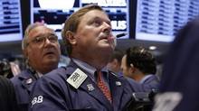 Trader Stephen Mara, centre, works on the floor of the New York Stock Exchange, Aug. 27, 2013. (Richard Drew/AP)