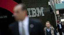 Pedestrians walk past International Business Machines Corp. offices in New York on Nov. 14, 2011. (Scott Eells/Bloomberg)