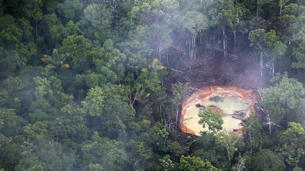An aerial view shows an illegal mine in the jungle in southern Venezuela. In the triangle that connects Venezuela, Brazil and Guyana illegal gold and diamonds prospectors or garimpeiros dream of changing their lives overnight by finding a huge bonanza. (JORGE SILVA/REUTERS)