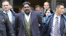 Raj Rajaratnam, billionaire founder of hedge fund the Galleon Group, is led in handcuffs from FBI headquarters in New York on Oct. 16, 2009. AP Photo/ Louis Lanzano (Louis Lanzano/AP)