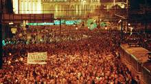 About 120,000 East German demonstrate for political reform in downtown Leipzig Monday, Oct. 16, 1989. For the first time the demonstrators carried banners in the peaceful protest march. Banner reads: 'Alternative service for conscientious objectors is a human right.' (AP Photo) (AP)