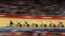 Rides follow a motor pacer during their track cycling men's keirin first round heat 2 at the Velodrome during the London 2012 Olympic Games on Tuesday. (PAUL HANNA/Reuters)