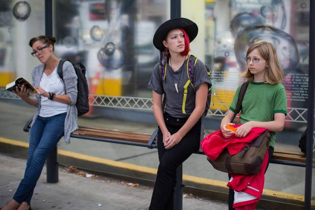 Eliana Gaertner, 14, and her brother Rowan, 12, wait for the city bus to take them to school in Vancouver.