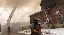 Toronto firefighters work to control a fire at a former church on Dufferin Street, south of Dupont St., Jan. 31, 2014. (Fernando Morales/The Globe and Mail)