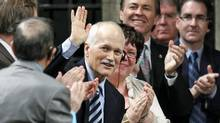 NDP Leader Jack Layton, who is recovering from hip surgery, acknowledges a standing ovation in the House of Commons on March 9, 2011. (CHRIS WATTIE/REUTERS)
