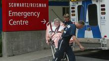 Toronto EMS paramedics bring a patient into emergency at Mount Sinai Hospital in Toronto on Aug. 15, 2003. (Donald Weber/The Globe and Mail/Donald Weber/The Globe and Mail)