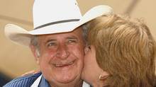 The premier gets a kiss at the Annual Ralph Klein Pancake Breakfast in 2006. (Larry MacDougal/THE CANADIAN PRESS)