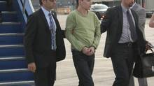 Luka Magnotta arrives at Montreal's Mirabel Airport. (Handout from Montreal Police)