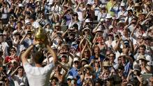 Canadian Michael Downey inherits enormous task of converting the popularity of superstar Andy Murray into increased tennis participation across Britain. (STEFAN WERMUTH/REUTERS)