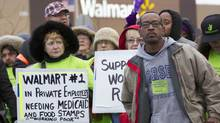 Protesters demonstrate outside a Wal-Mart store in Chicago Nov. 23, 2012. Black Friday, the day following the Thanksgiving Day holiday, has traditionally been the busiest shopping day in the United States. (JOHN GRESS/REUTERS)