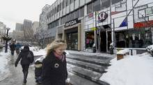 A woman walks past a Lululemon outlet in downtown Toronto, Feb. 6, 2014. (Fred Lum/The Globe and Mail)