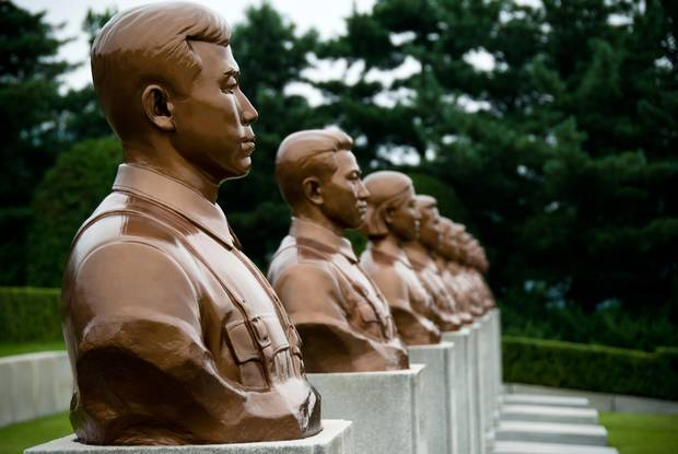 Many hours were spent being shuttled around Pyongyang and Kaesong – from one enormous grey or bronze monument to another. North Korea. Revolutionary Martyrs' Cementary.
