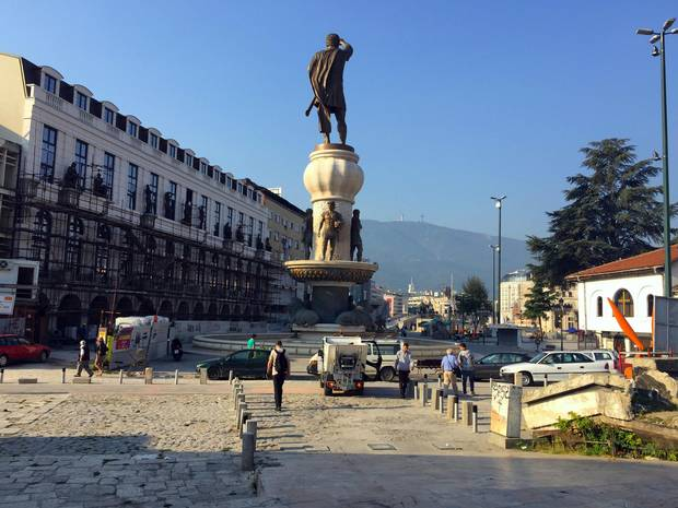 The largest of Skopje's giant statues, a towering rendition of Alexander the Great, appears to dwarf its neighbour, a brand-new five-star Marriott.