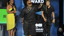 Justin Bieber accepting the Milestone Award at the Billboard Music Awards at the MGM Grand Garden Arena on Sunday, May 19, 2013 in Las Vegas. (Chris Pizzello/AP)