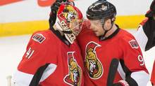 Ottawa Senators goalie Craig Anderson is congratulated by left wing Milan Michalek following their win against the Buffalo Sabres at the Canadian Tire Centre. (Marc DesRosiers-USA TODAY Sports/USA Today Sports)