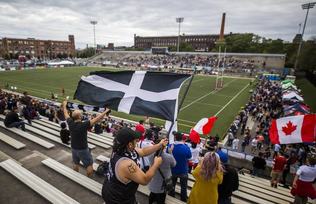 Fans wave flags as the Toronto Wolfpack play the Whitehaven RLFC at Lamport Stadium in Toronto on Saturday Sept. 2, 2017.