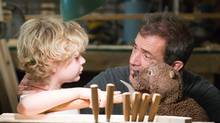 """Riley Thomas Stewart (left) and Mel Gibson in a scene from """"The Beaver."""" (Ken Regan/AP)"""
